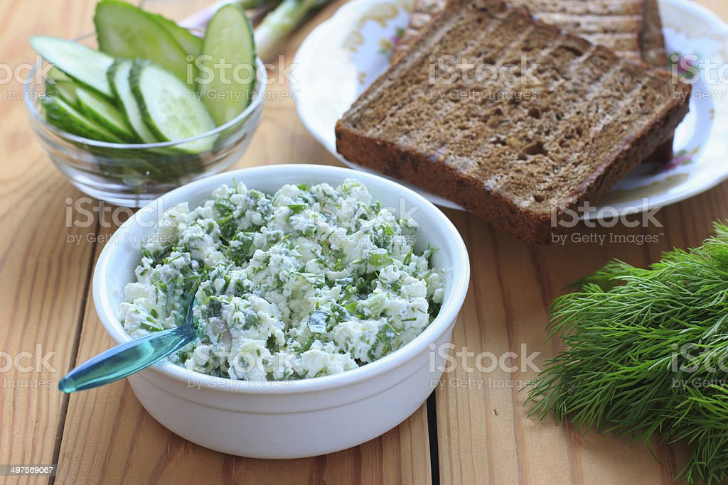 Cottage cheese with chives, garlic and dill stock photo