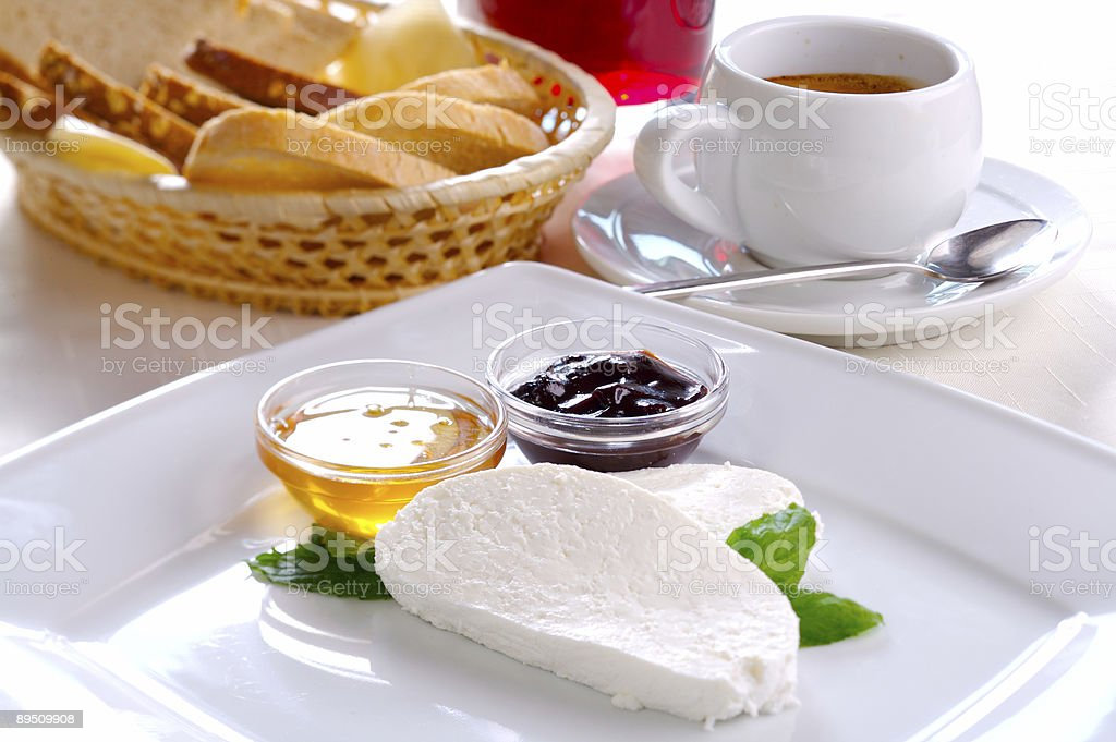 Cottage cheese with honey andl plum jam royalty-free stock photo