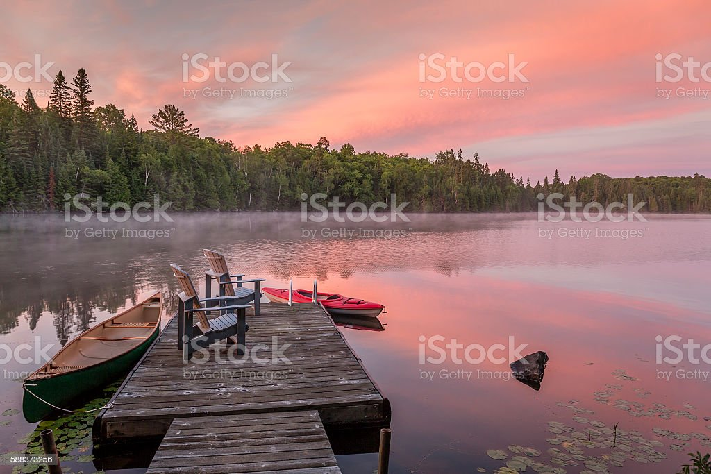 Cottage Dock on a Canadian Lake at Dawn at Dawn stock photo