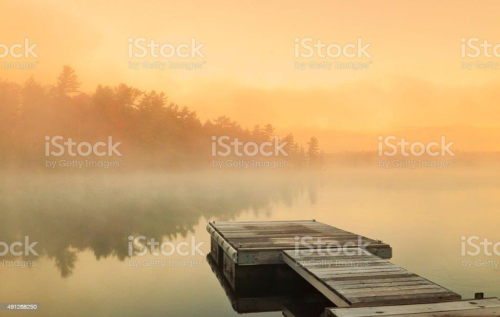 Cottage Foggy Sunrise stock photo