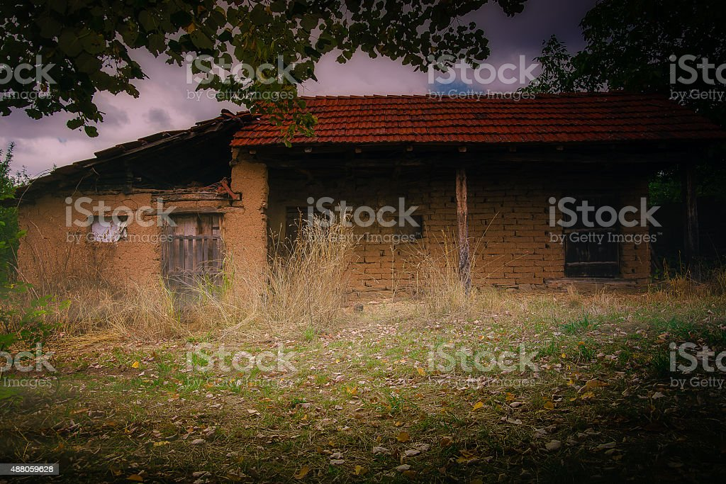 Cottage from clay bricks stock photo