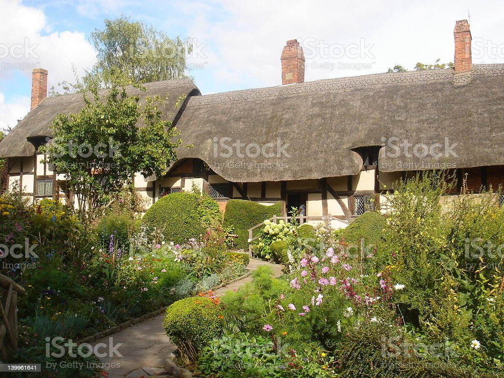 Cottage garden set against a blue cloudy sky royalty-free stock photo