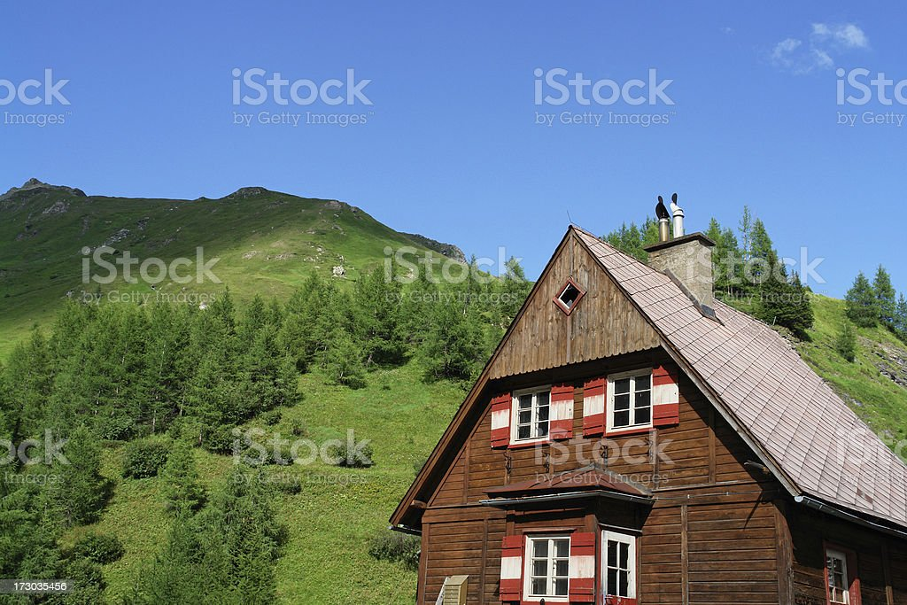 Cottage in Austrian Alps royalty-free stock photo