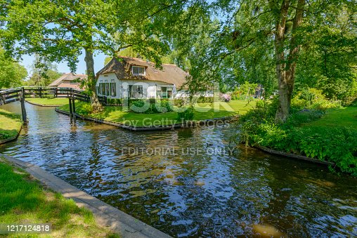 Cottage in the village of Giethoorn in The Netherlands. The village of Giethoorn is only fully accessible by boat, is commonly known as the Venice of the North and has over 180 bridges. Giethoorn is a very popular attraction among Chinese tourists.