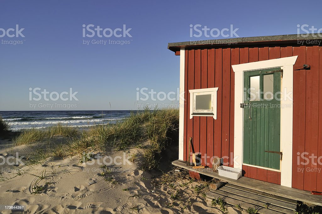 Cottage on the beach royalty-free stock photo