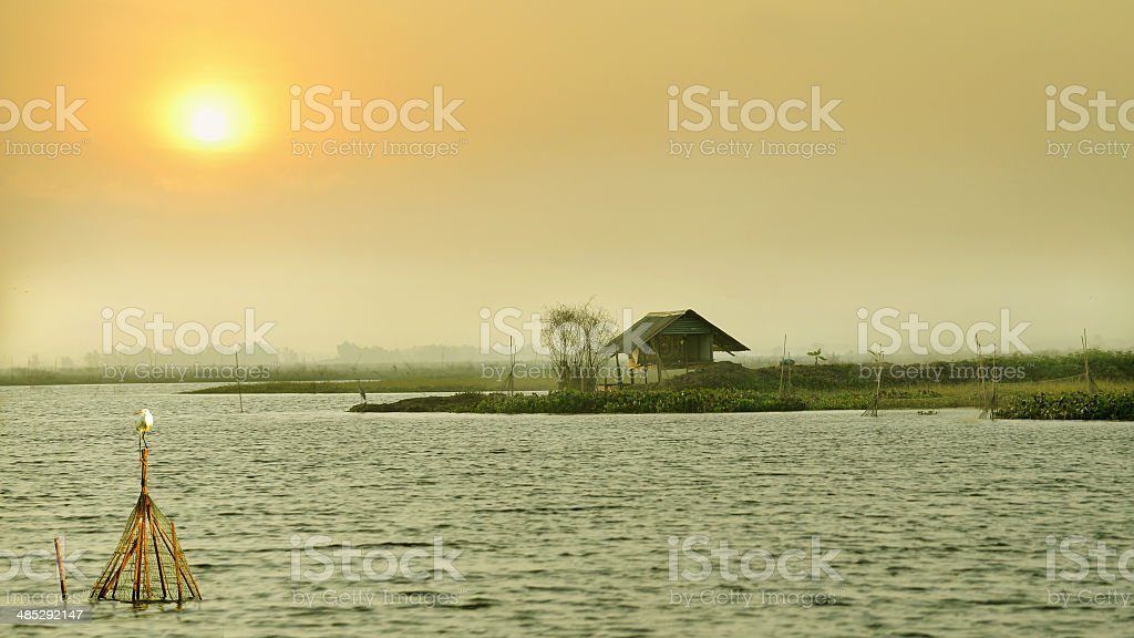 Cottage on the lake at sunrise royalty-free stock photo
