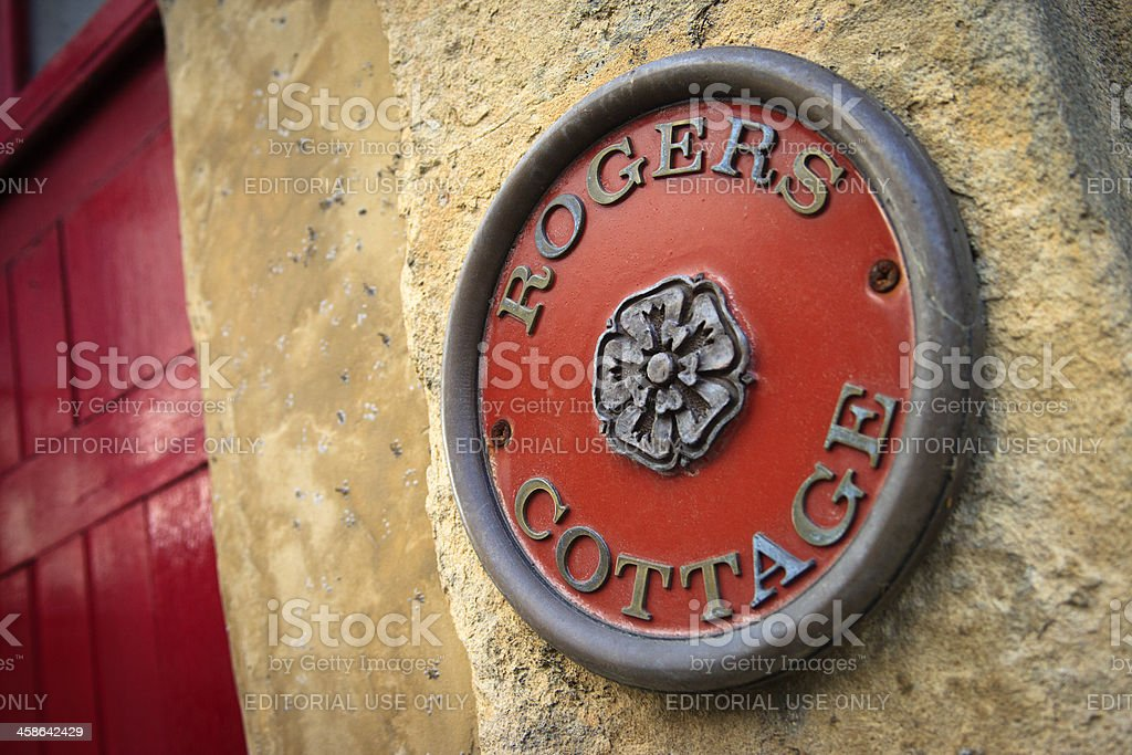 Cottage plaque on a stone wall, Cotswold, England stock photo