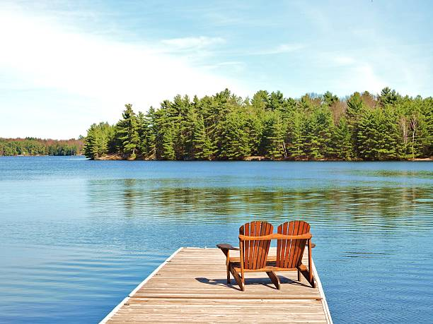 cottage time - lake stock photos and pictures