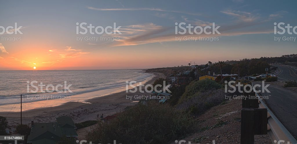 Cottages along Crystal Cove Beach at sunset stock photo