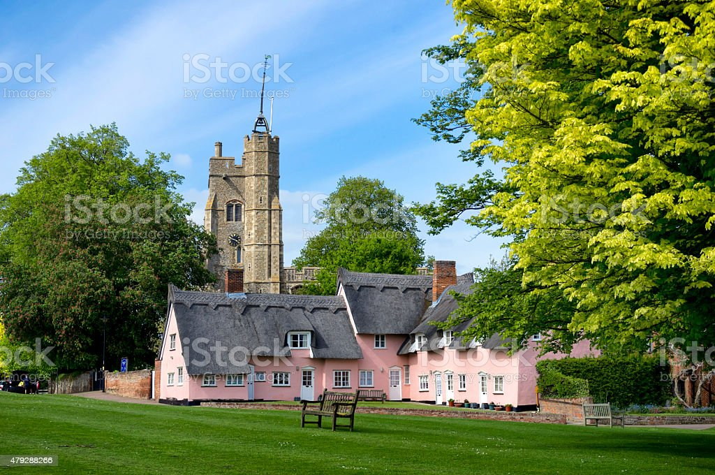Cottages, church and village green, Cavendish, Suffolk stock photo