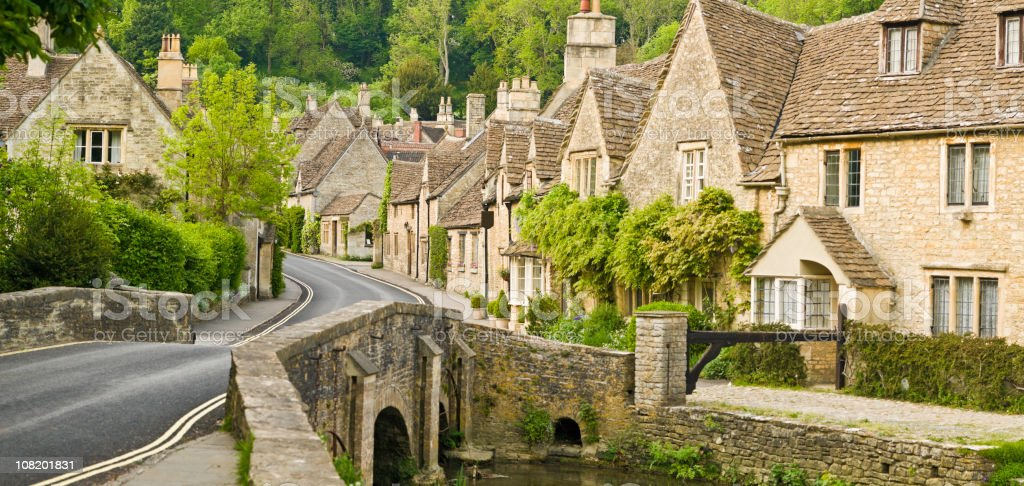 Cottages Lining Road in Green Wooded Valley stock photo