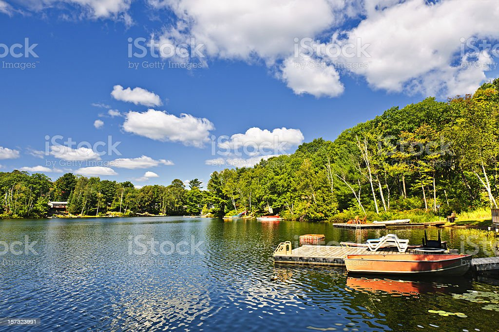 Cottages on lake with docks stock photo