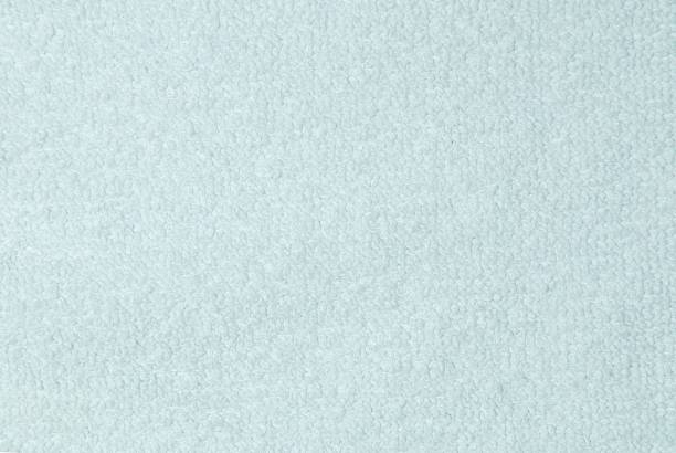 baumwoll-hintergrund - teppich hellblau stock-fotos und bilder