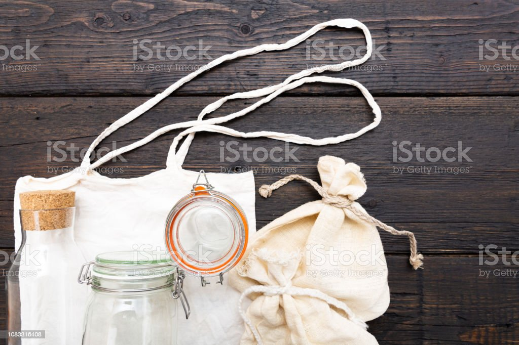 Cotton bags and glass gar for free plastic shopping. Zero waste concept stock photo