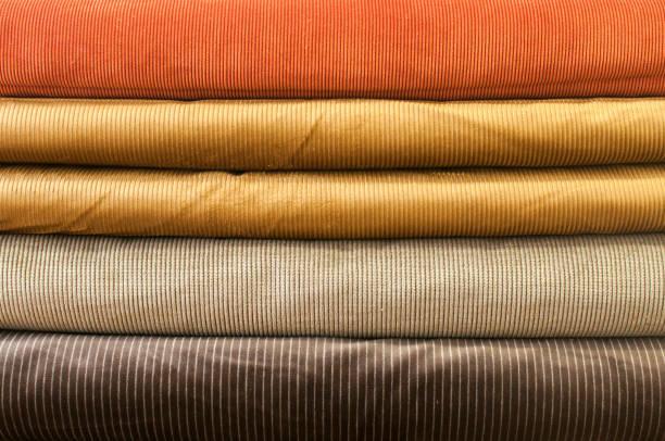 cotton corduroy fabric closeup - corduroy stock pictures, royalty-free photos & images