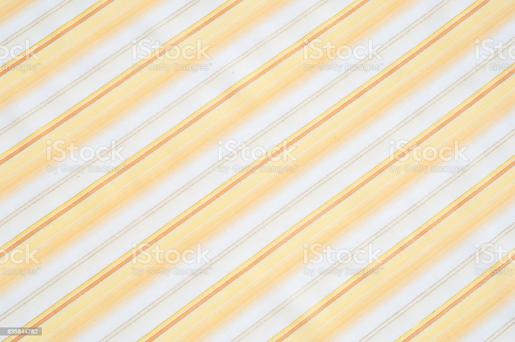 Cotton fabric texture, background, striped, with yellow stripes stock photo