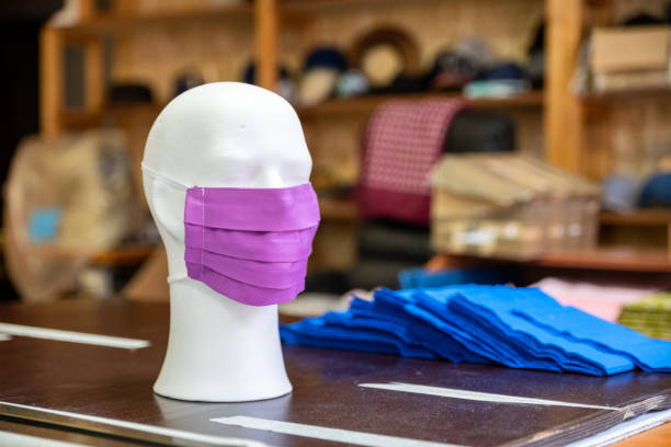 Cotton face mask in tailor's workshop stock photo