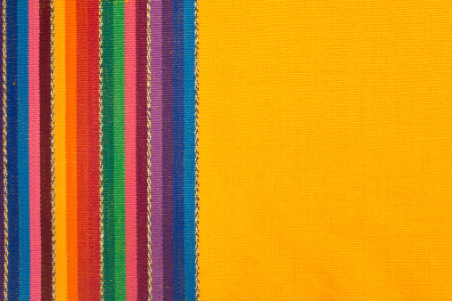 Bunch of colorful cotton napkins stacked on top of each other.