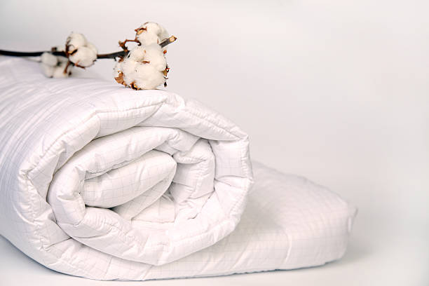 Cotton on duvet. Cotton on duvet. duvet stock pictures, royalty-free photos & images
