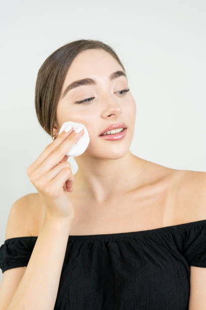 Cotton pad model woman face, cosmetology remover makeup, clear. stock photo