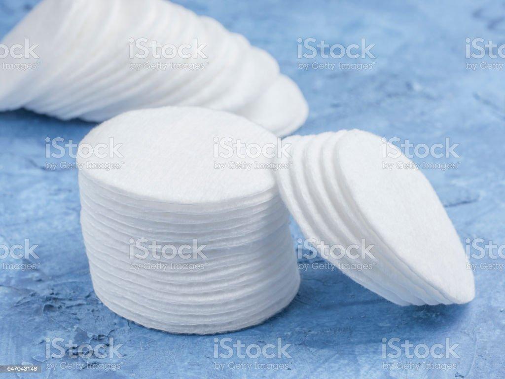 cotton pads on blue concrete background stock photo