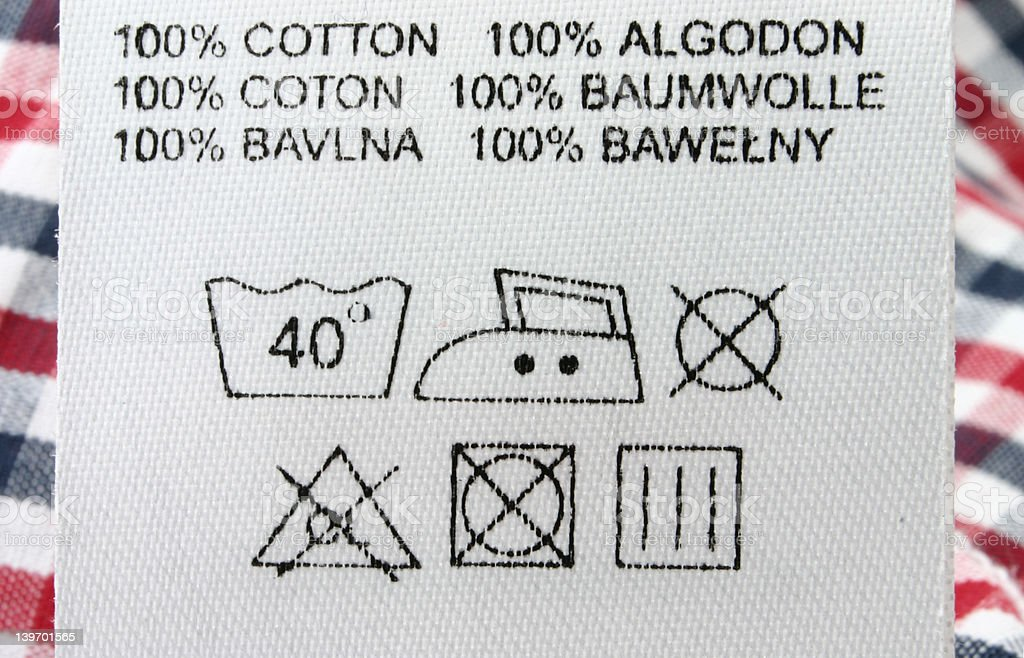 100% cotton  - real macro of clothing label stock photo