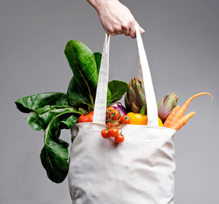 Cotton shopping bag overflowing with vegetables