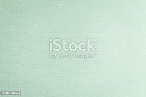 859441184istockphoto Cotton silk blended fabric wallpaper texture pattern background in light pale pastel green color 1185316624