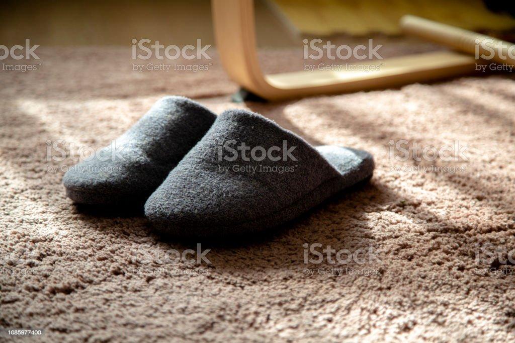 cotton slippers on carpet stock photo