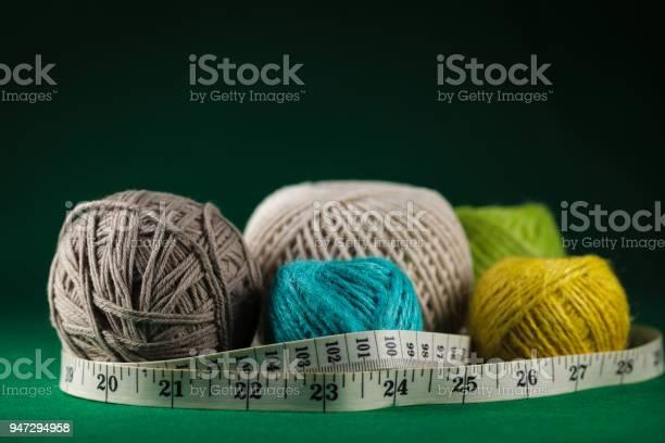 Cotton string balls with tape measure on a green background picture id947294958?b=1&k=6&m=947294958&s=612x612&h=vavutaeooliwlfce2vioerw4kpaemzeo8fmedjnjf0y=