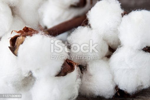 istock Cotton wool close up against wooden background 1127130933