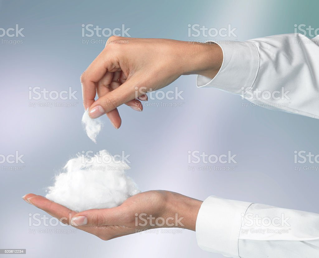 cotton wool in hand stock photo