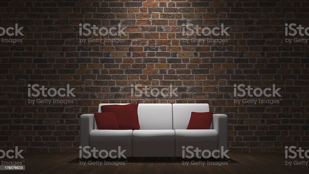 Couch and brick wall stock photo