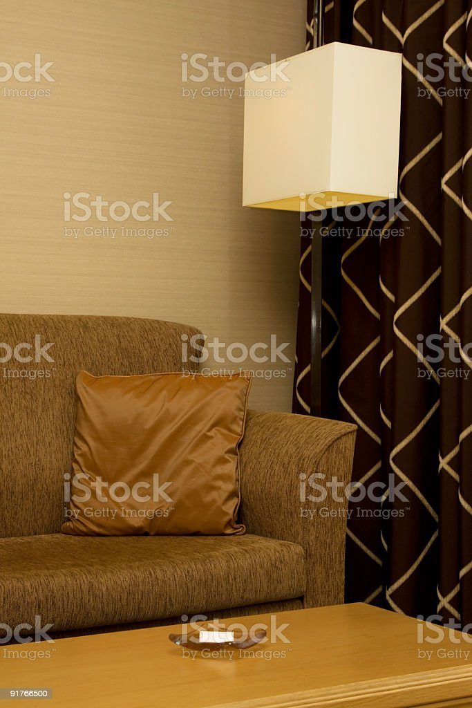 Couch and Curtain from a Hotel Room royalty-free stock photo