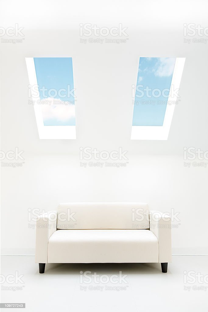 Couch Below White Room with Skylights royalty-free stock photo