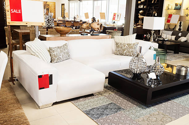 couch on sale at upmarket home decor outlet - furniture shopping stock photos and pictures