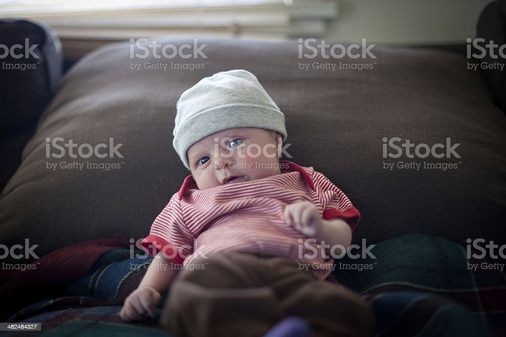 Couch potato baby stock photo