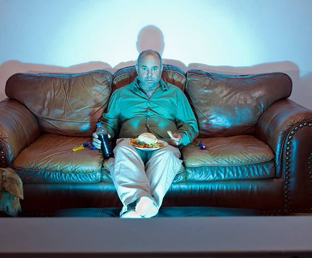 couch potato - laziness stock photos and pictures