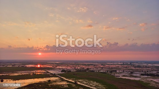 istock Coud colorful bright pink sunset shot from the drone 1257029369