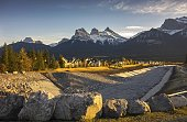 Cougar Creek Berm Town of Canmore Alberta Foothills with Distant Snowy Three Sisters Mountain Landscape near Banff National Park in Canadian Rockies