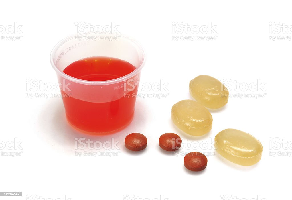 Cough Syrup, Throat Lozenges, and Ibuprofen royalty-free stock photo