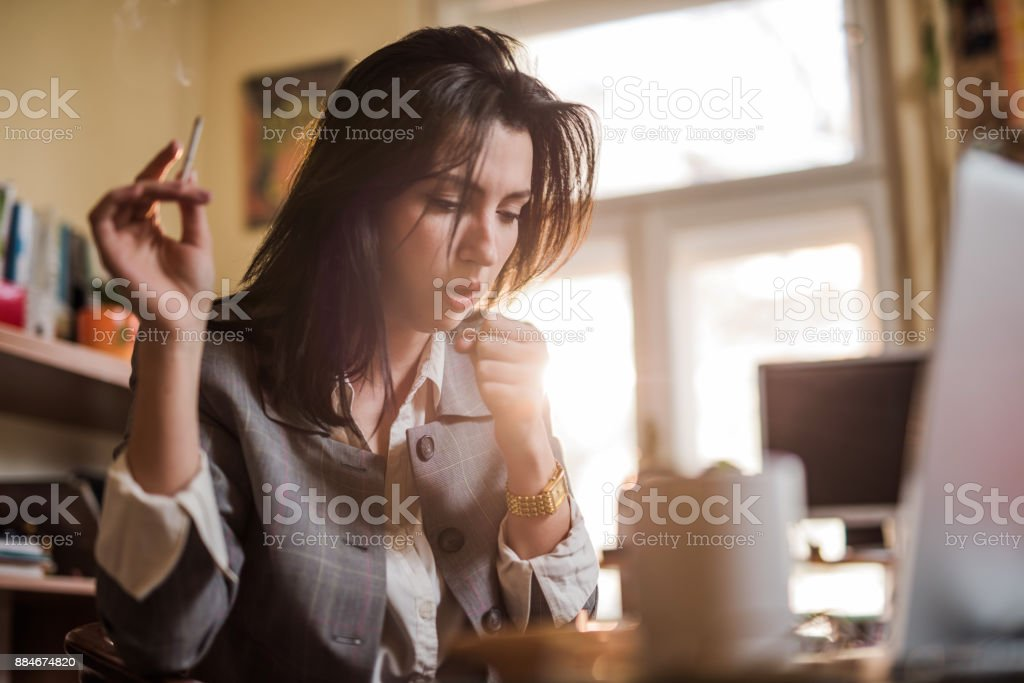 Coughing from cigarettes. stock photo