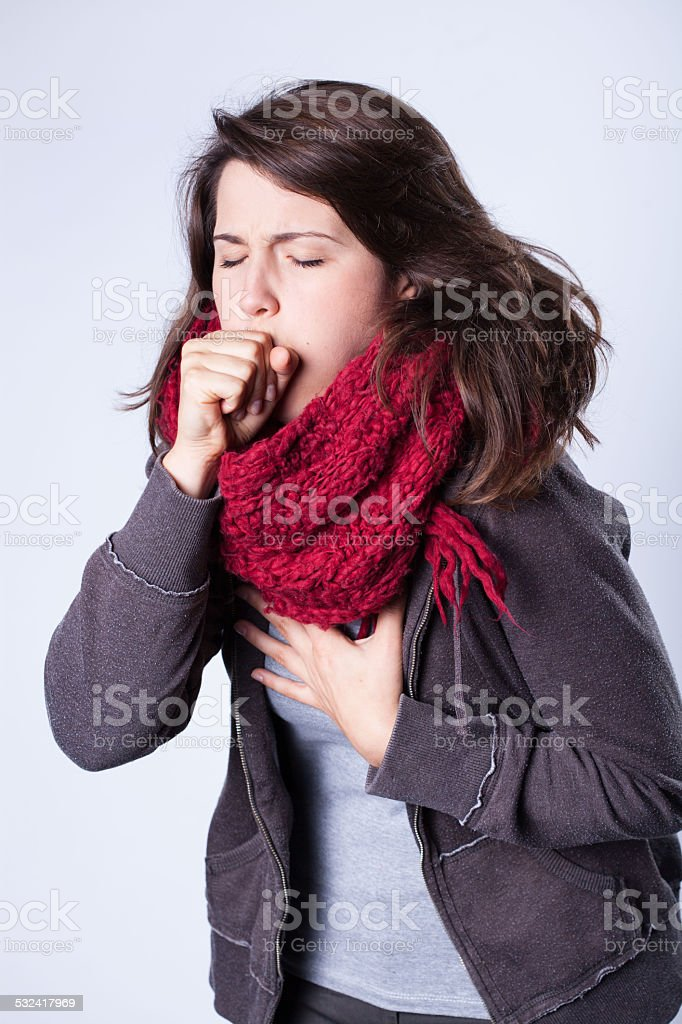 Coughing girl in scarf stock photo