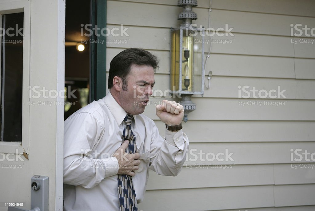 Coughing in Doorway royalty-free stock photo