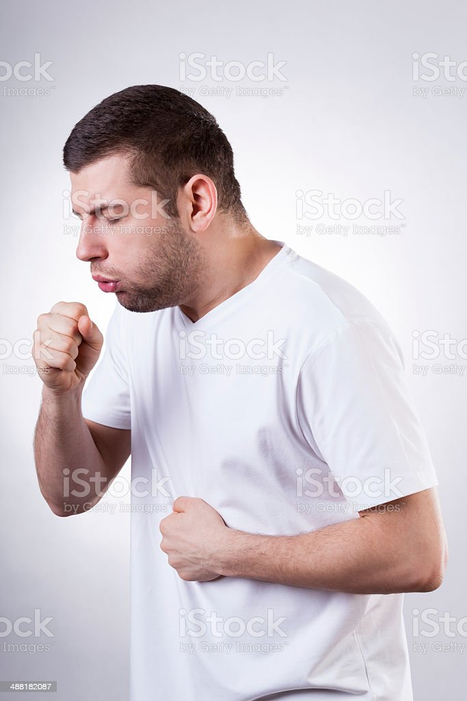 Coughing man stock photo