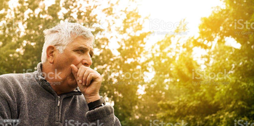 Coughing senior man. stock photo