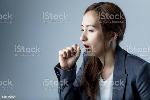 Coughing woman catching a cold health care concept picture id858485054?b=1&k=6&m=858485054&s=612x612&h=ij9u1eyovkjg8or3l5yimlpmzrxo9u2xkdis6n6bp w=