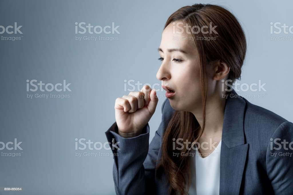 coughing woman. catching a cold. health care concept. stock photo