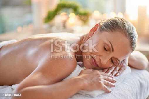 Shot of a mature woman relaxing on a massage table at a spa