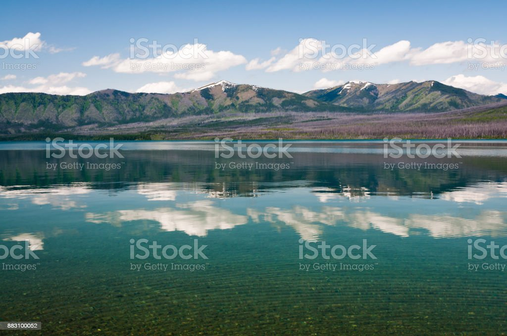 Coulds reflection in Lake McDonald stock photo